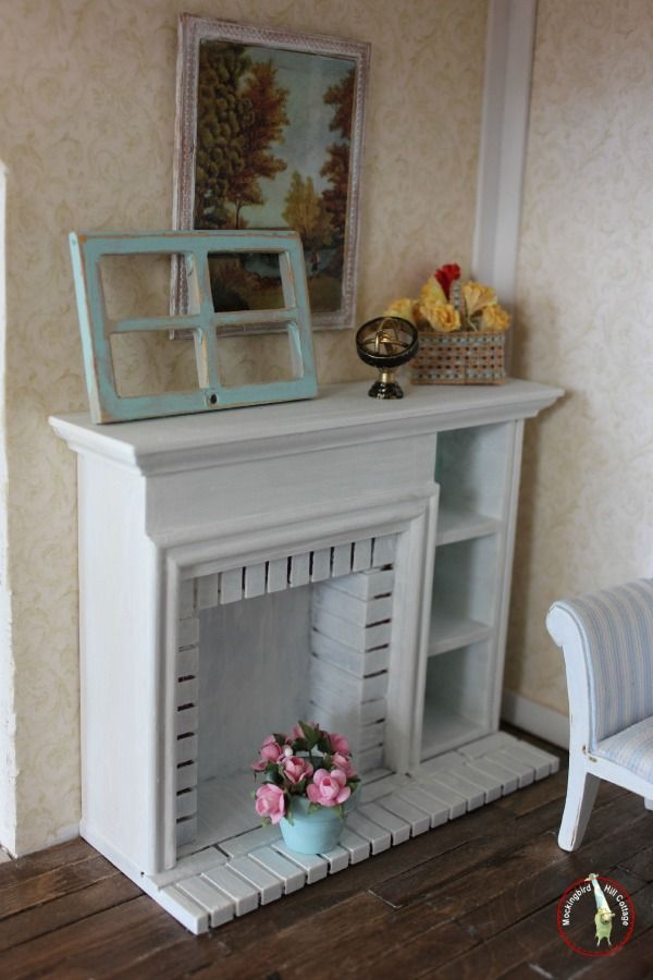 The newly refinished fireplace, which is made out of molded plastic. I didn't like it at first, but some paint and some mantel decorating changed all that!