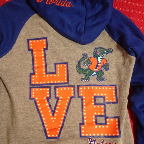 florida gators hoodie heather grey florida gator hoodie with front pocket.excellent condition.only flaw is shown in last photo and it isnt noticeable.glitter LOVE on back.florida in cursive on the hood and gator head symbol on the front super cute and comfortable.go gators  Soffe Tops Sweatshirts & Hoodies
