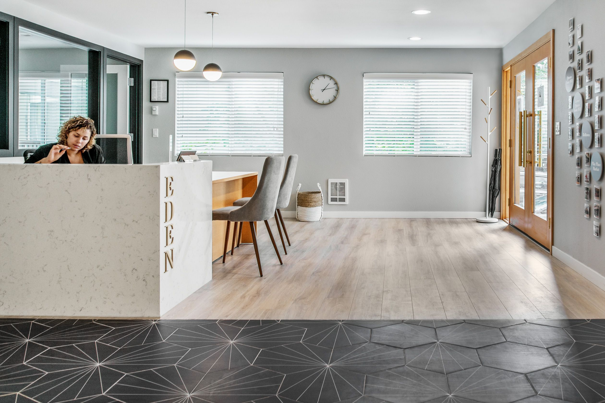 Geometric floor tile accents this front lobby desk at The