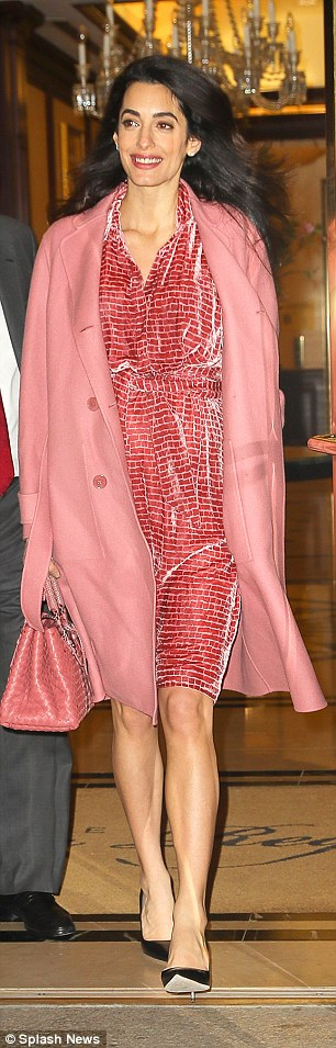 Pregnant Amal Clooney displays her growing bump in pink ensemble #dailymail