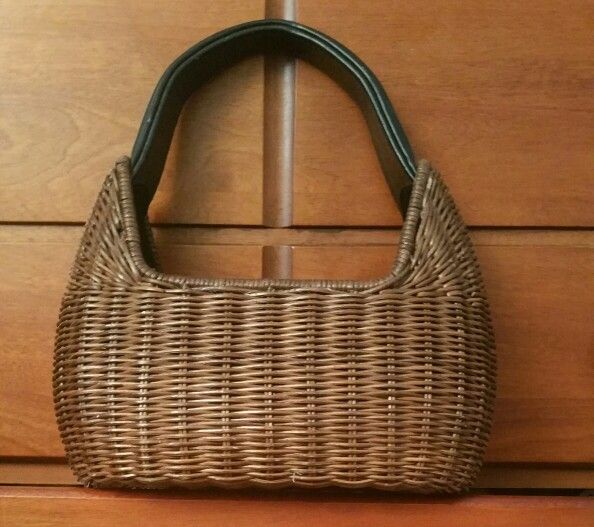Small basket with black handle.