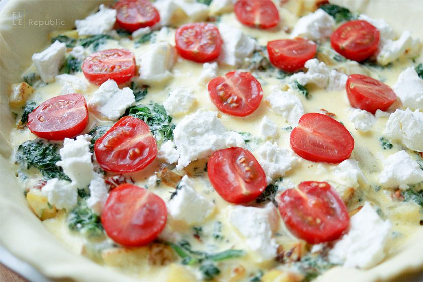 easy to prepare spinach, goat cheese and potato quiche recipe made with crème fraîche, sun-dried tomatoes, baby roma tomatoes and fresh thyme