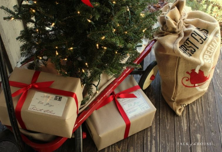 Christmas tree in wagon and packages