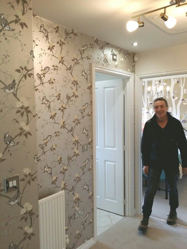 Taylor Wimpey Homes - Jasmine Gardens.  My man (!) and the Avarium silver Bird wallpaper in the landing on one wall with the woodland kids bedroom behind. Brilliant hallway / landing decorating idea