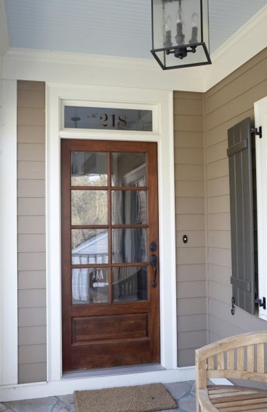 I Love The Wooden Front Door With The Transom Window Above It The House Number On It Is An Wood Exterior Door French Doors Exterior Exterior Doors With Glass
