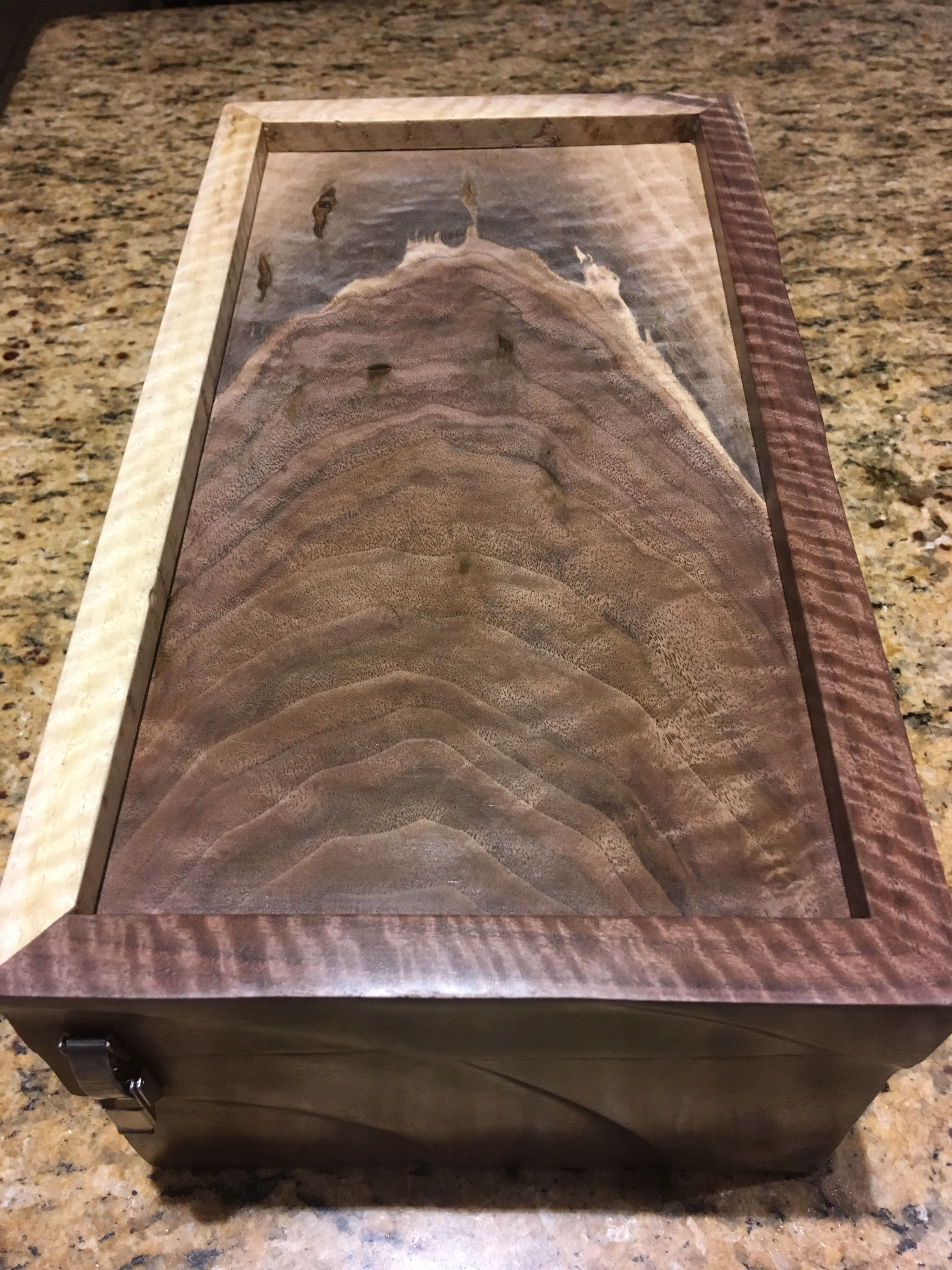 Keepsake box made from curly black walnut.  Made by 5&2 Woodworks.