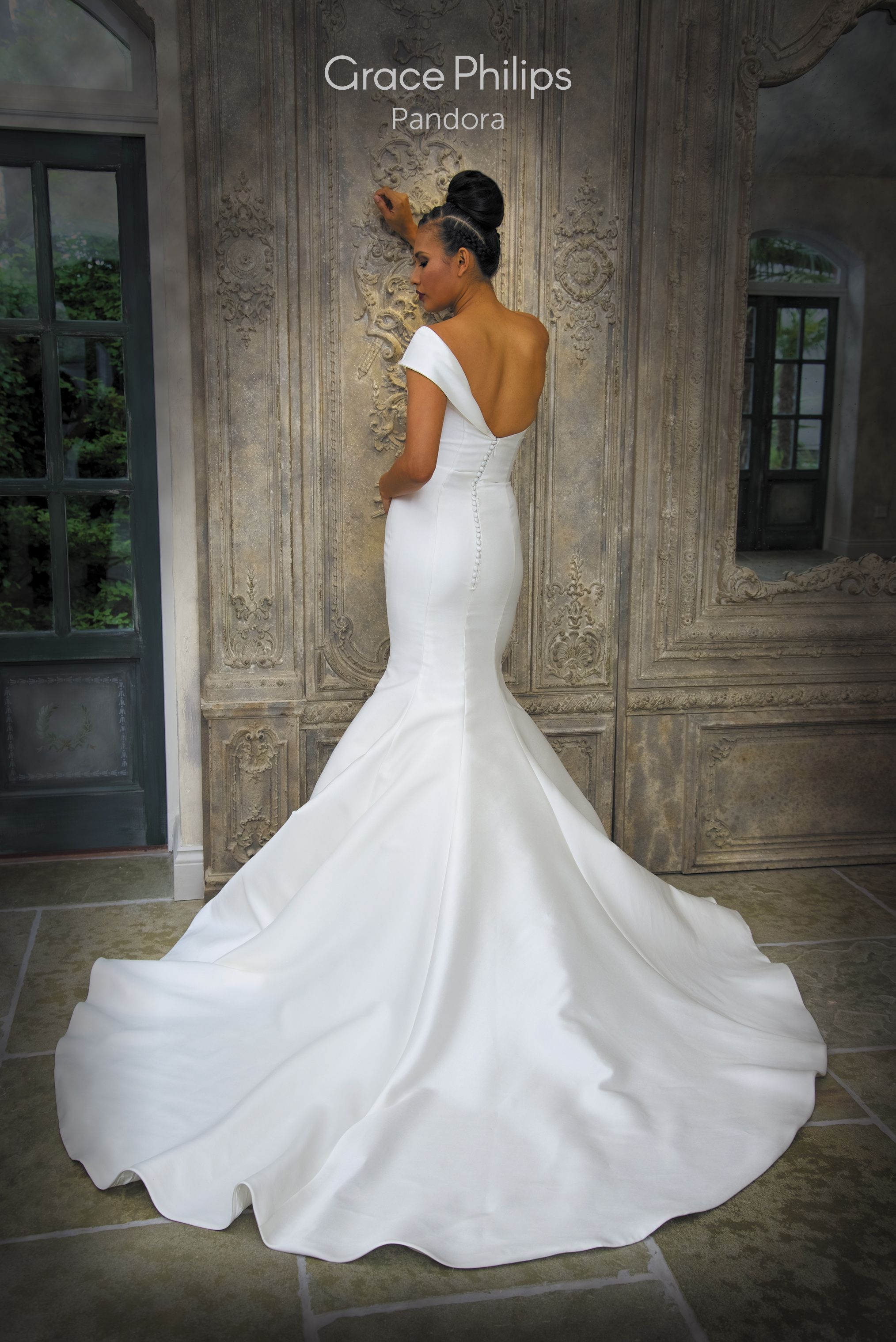 A Mikado fit n flare fishtail wedding dress complete with