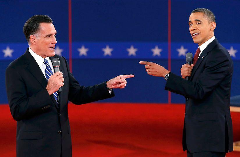 143 10/16/12 - Republican presidential nominee Mitt Romney, left, and President Barack Obama gesture towards each other during the second U.S. presidential debate in Hempstead, N.Y., on Oct. 16, 2012. (REUTERS/Mike Segar)