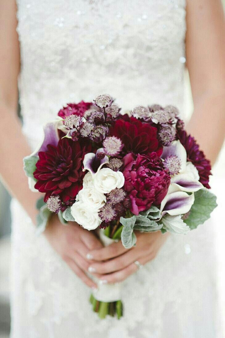 Elegant bridal bouquet arranged with red violet dahlias for Red wedding flower ideas