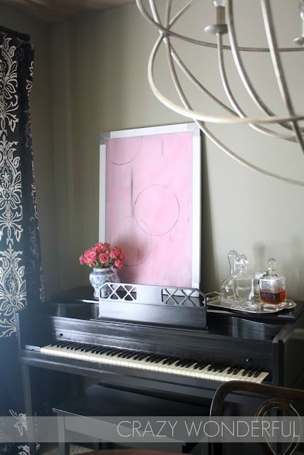 I'm still trying to decide what to put above/on my piano. If I rest a frame, it might make noise when I play, but I love this decor!