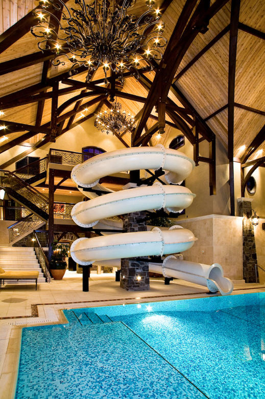 Its All About The Slide Indoor Swimming Pool Design Indoor Pool Design Luxury Homes Dream Houses