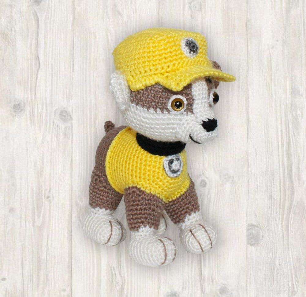 Rubble Pup Paw Patrol Crochet Pattern Crochet pattern by Kristine Kuluka - Crochet dog, Crochet patterns amigurumi, Crochet patterns, Paintbox yarn, Paw patrol, Christmas knitting patterns - Rubble Pup Paw Patrol Pattern, crochet puppy pattern, dog crochet pattern, puppy crochet pattern, rubble crochet pattern, paw patrol crochet This listing is for amigurumi pattern to help you create your very own Rubble Pup  This PDF file is 12 pages long and contain many detailed stepbystep photographs along with full pattern instructions  The supplies you will need • Approx  25g  Yellow Color Yarn (double knitting approx  290metres in 100g) • Approx  20g  Brown Color Yarn • Less than 20g  White Color Yarn • Less than 5g  Black Color Yarn • Less than 5g  Grey Color Yarn • A Pair of 810mm Brown Plastic Eyes (beads, halfbeads, buttons) • 2mm Crochet Hook • Toy Stuffing • Sewing Needle • Tweezers for stuffing See more See less