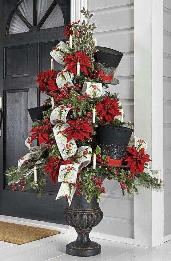 I love this topiary and urn. Poinsettias, top hats, and gorgeous ...