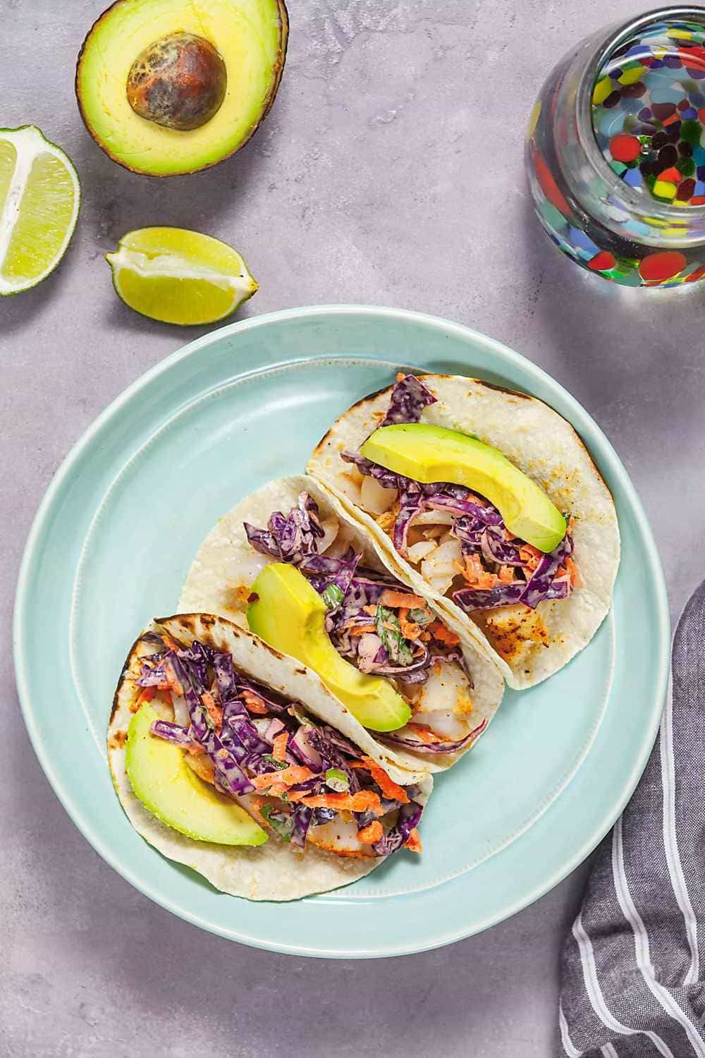 Grilled Fish Tacos Topped With Fresh Spiced Coleslaw Creamy Avocados And Tart Lime Juice Are The Answer To The Grilled Fish Tacos Fish Recipes Trout Recipes