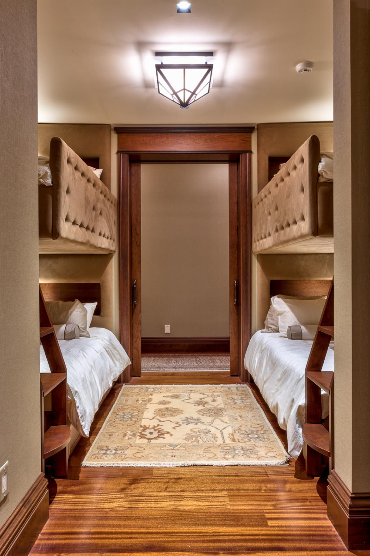 This Guest Room Features Two Bunk Beds That Provide Plenty Of Space For  Visitors. Tufted
