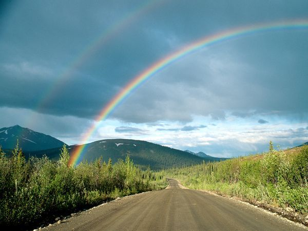 Photograph by Rich Reid by Rich Reid A rainbow stretches over a section of the 670-mile-long (1,100-kilometer-long) Denali Highway in Alaska. Rainbows are a simple, ordered display of visible light reflected off of water droplets in the atmosphere.