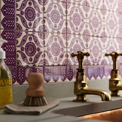plum spanish tile backsplash, vintage brass fixtures, and soapstone countertops.