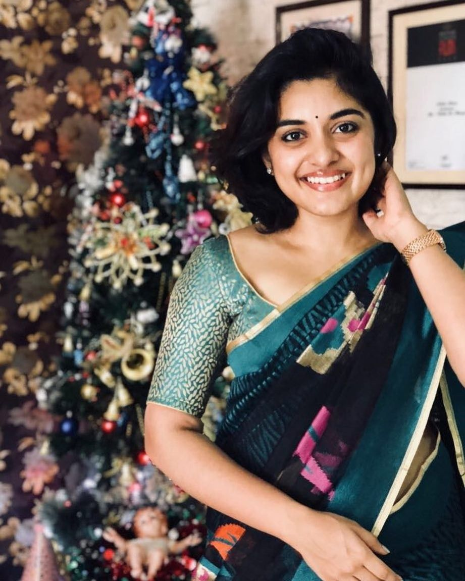 Nivetha Thomas In Black Saree And Light Green Blouse Designerblouse Festivevibes Indianwear Saree Saree Hairstyles Cool Hairstyles Women