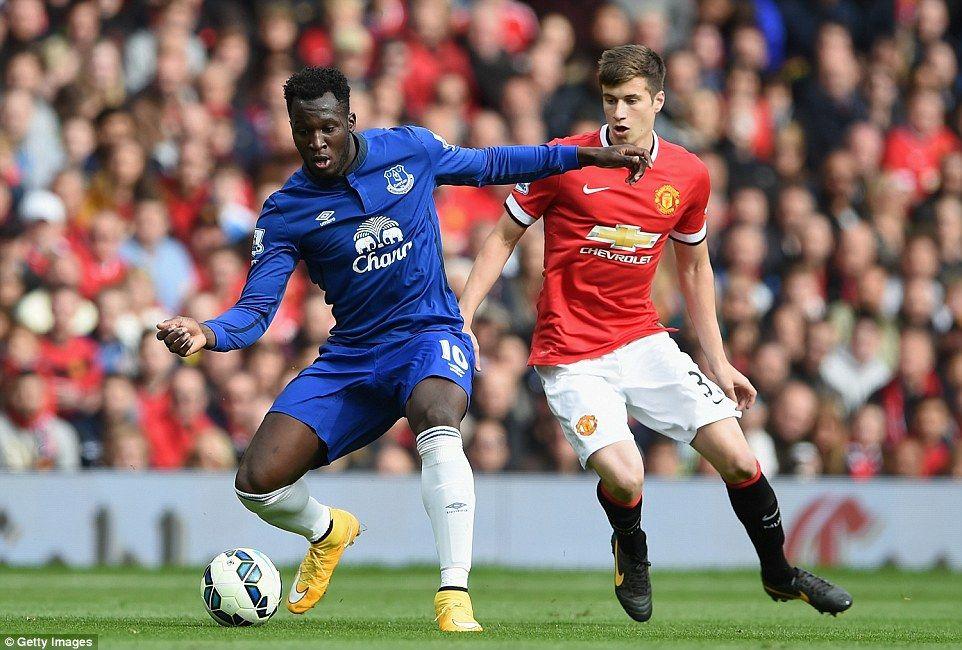 United's teenage centrehalf Patrick McNair keeps a close
