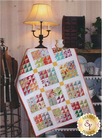 Urban Primitive Pattern: Urban Primitive is a lovely vintage triangle lap quilt sure to brighten anyone's day! This quilt includes instructions to complete a quilt measuring 32