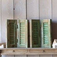 Chippy Green with Brown Peaking Through Vintage Shutters