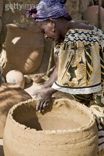 Africa Potter Making Large Clay Pots At The Village Of