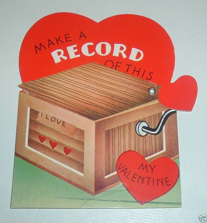 Vintage mechanical Valentine with a record theme. The lid on the victrola moves.  A-meri-card, Made in USA.