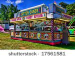 View of concession stand of cotton candy and caramel apples at a carnival.