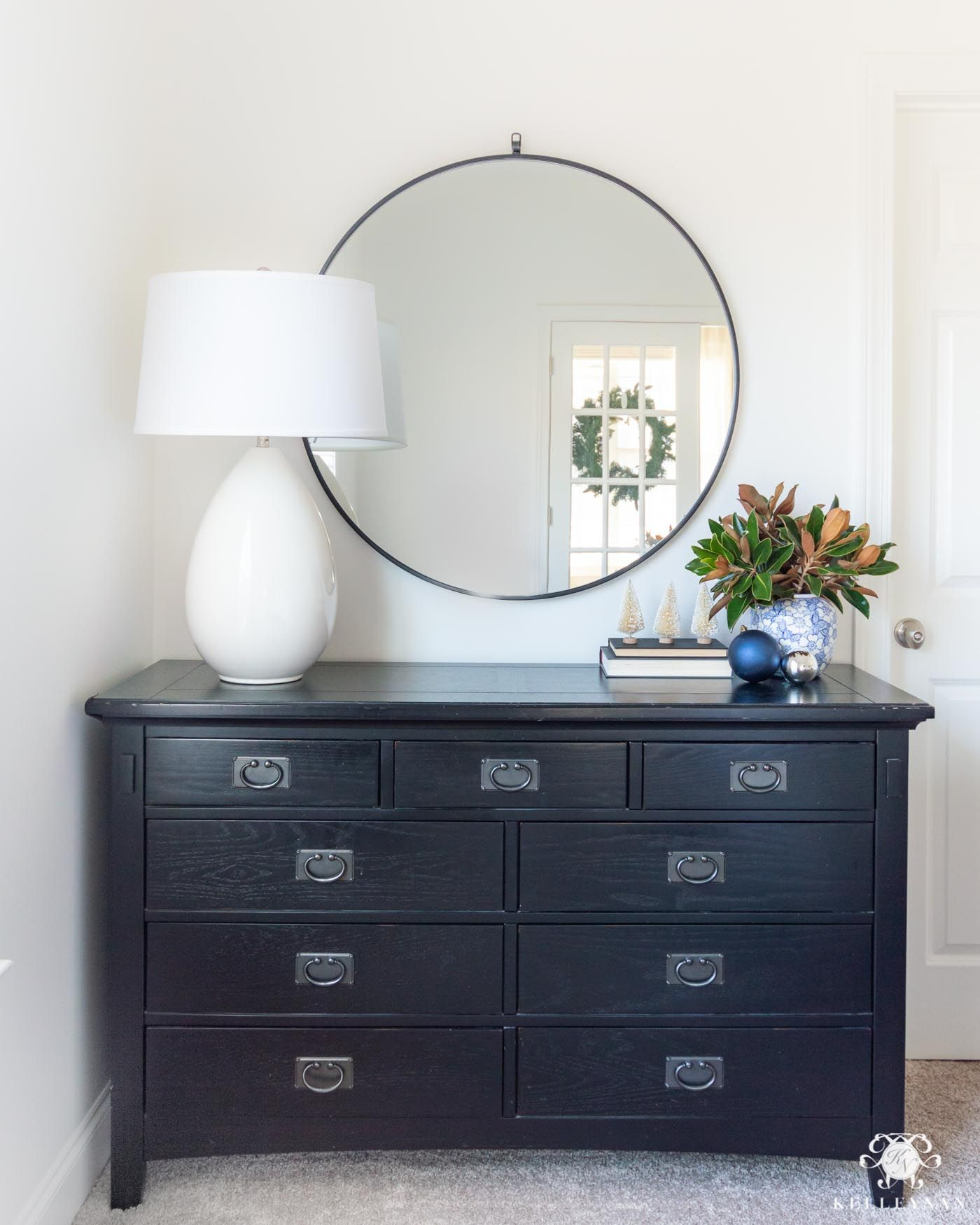 How To Style And Decorate A Bedroom Dresser With A Round Mirror White Lamp Winter Floral Arrangement And Chris Dresser Decor How To Decorate A Dresser Decor [ 1750 x 1400 Pixel ]