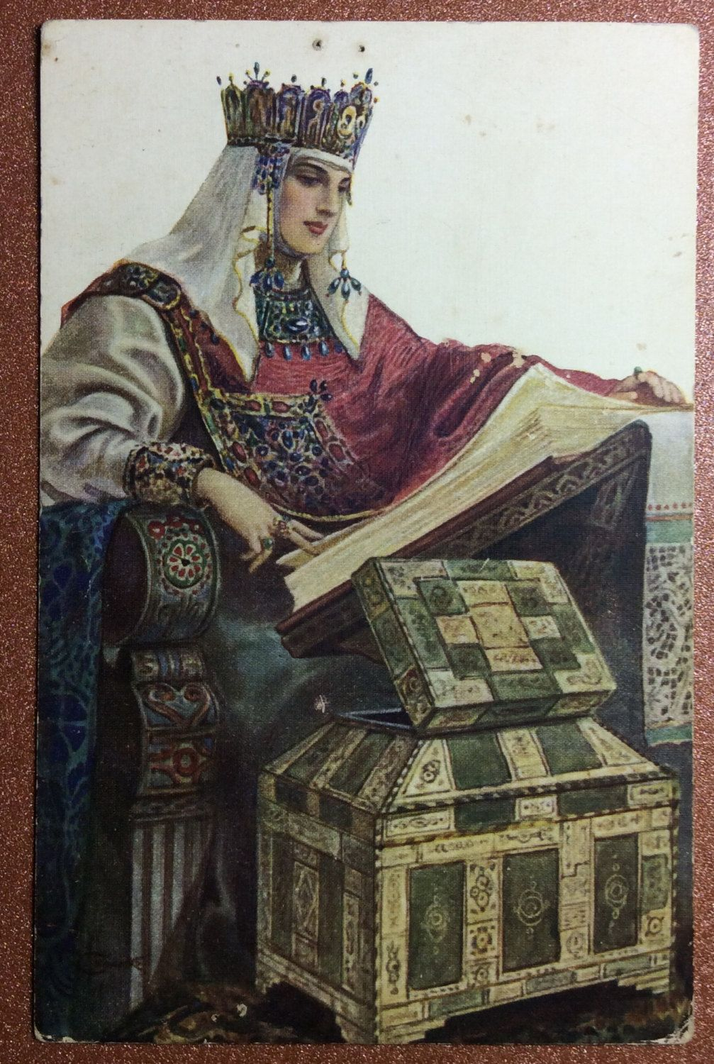 Antique Russian postcard with a woman wearing a stylised Russian costume