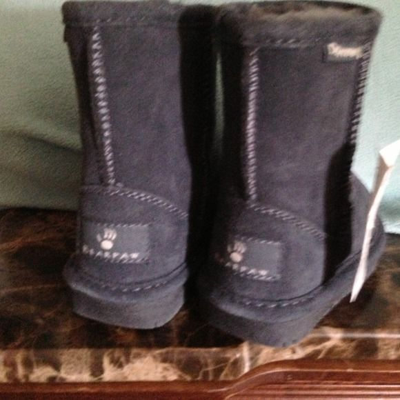 Bearpaw childs boots Dark blue new with tags childs boots. I have two pairs to sell separately one size 8 child's and one size 7 child's . New with tags. bearpaw Shoes