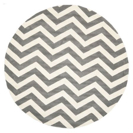 Hand-tufted wool rug with a grey and ivory chevron motif.  Product: RugConstruction Material: WoolCo...