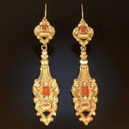 A pair of Victorian earrings, circa 1830's, crafted in France, 18kt yellow gold and carnelian stones, French wire closure