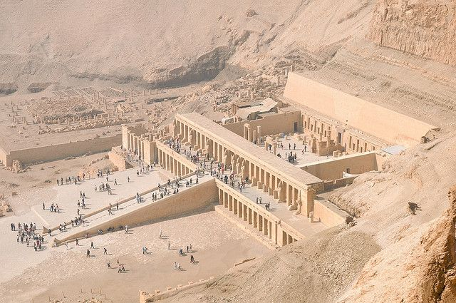 The Mortuary temple of Hatshepsut. c1479 BC. It is a colonnaded structure, which was designed and implemented by Senemut, the royal architect of Hatshepsut, to serve for her posthumous worship and to honor the glory of Amun. The temple is built into a cliff face that rises sharply above it and consists of three layered terraces reaching 30 meters (97 ft ) in height. These terraces are connected by long ramps which were once surrounded by gardens.