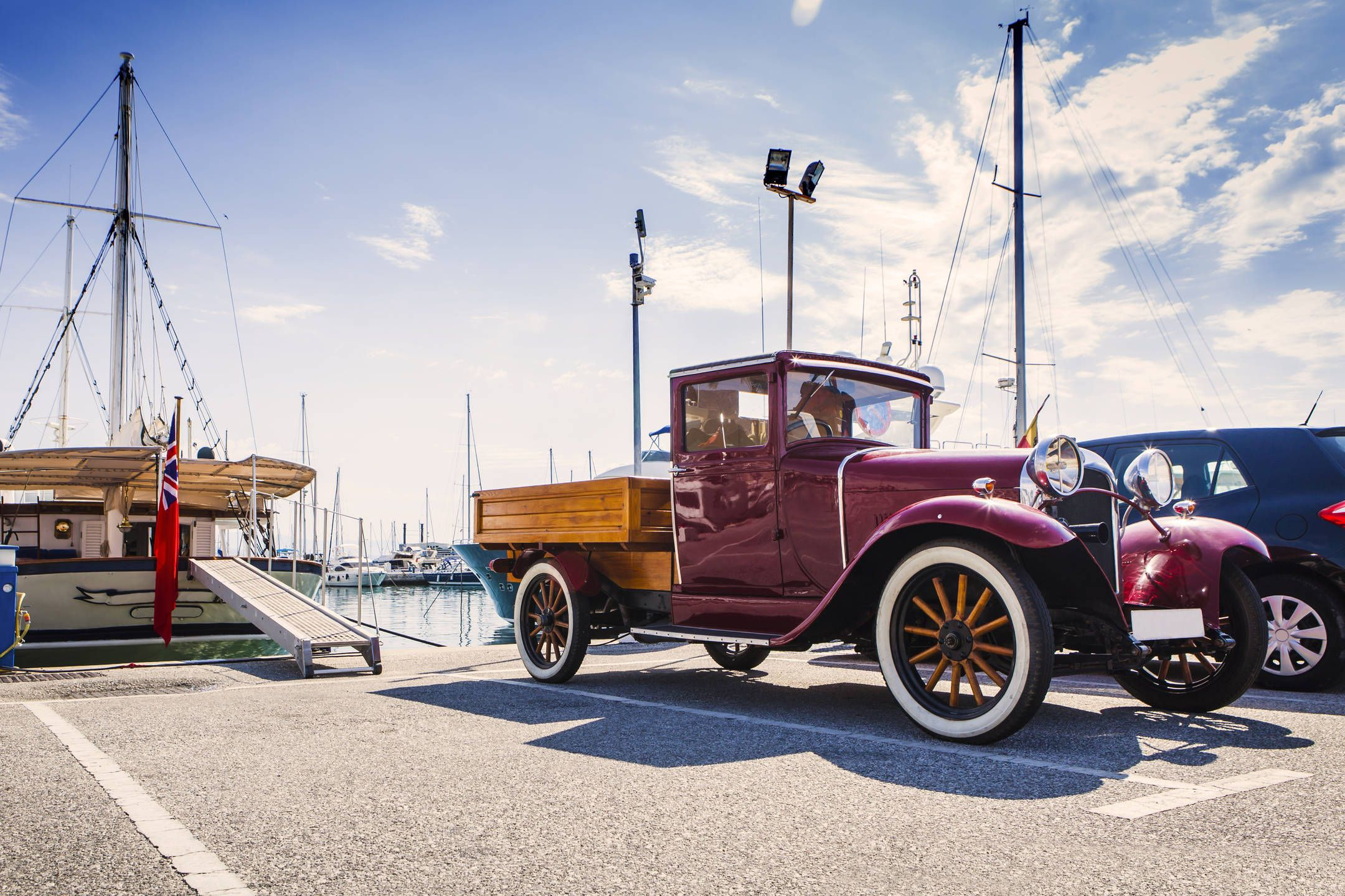 Old style car on a port – One look at this vintage automobile is ...