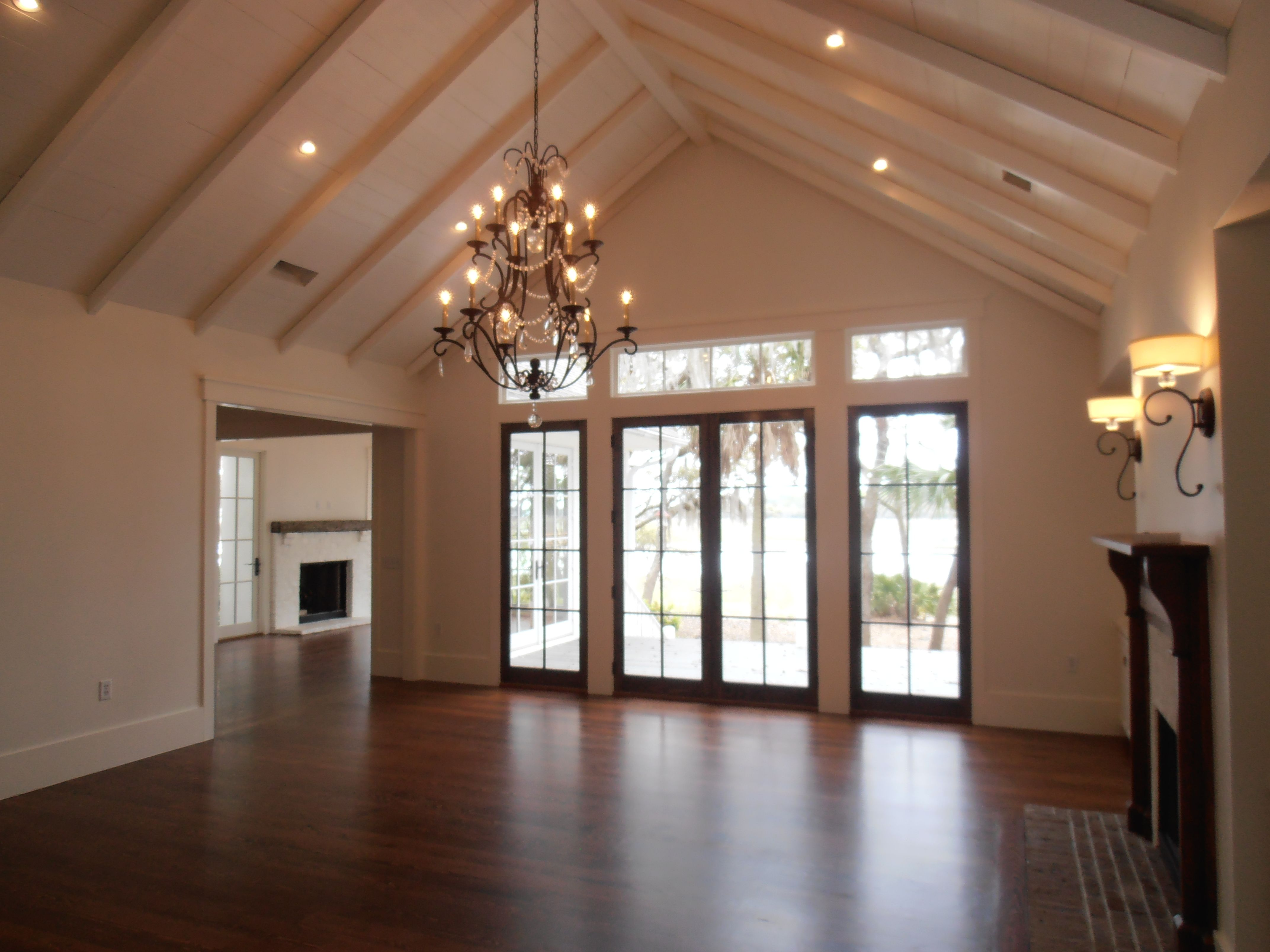 Board Ceiling Treatment With Beams Cathedral Recessed Lighting Chandelier Cherokee Brick Hearth Flush Stationary Door Panels