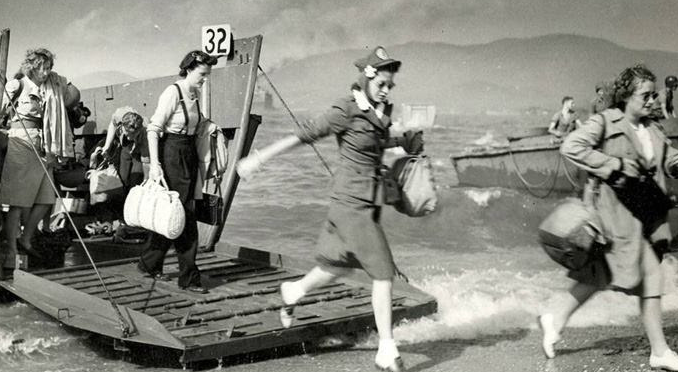 -- an image not seen often at all. this is a photo of women arriving, shortly after the men/soldiers did at normandy beach in 1944. these women were part of the red cross efforts which took place shortly after the invasion. yes, we honor those men that stormed the beach that day, but let's honor these lovely ladies for doing the same---to help! ...