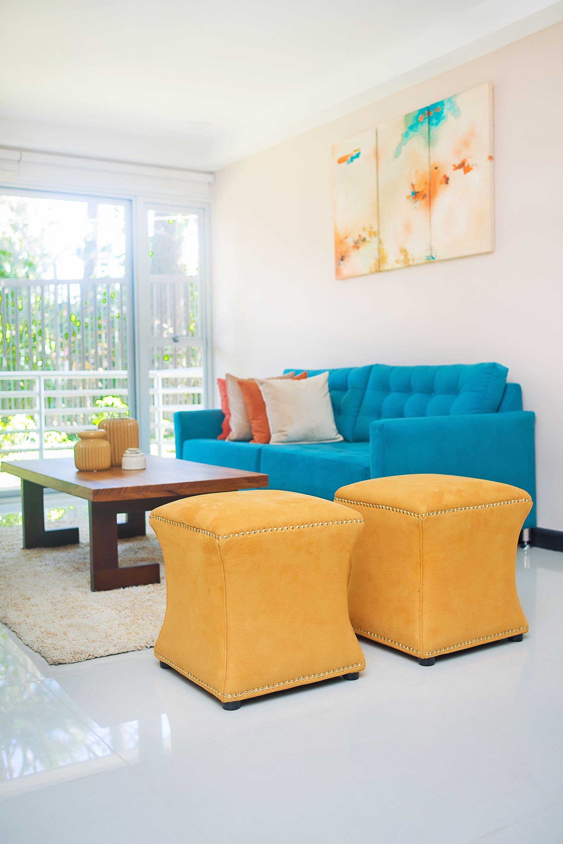 La decoraci n de esta sala de estar es muy armoniosa con for Decoracion hogar naranja