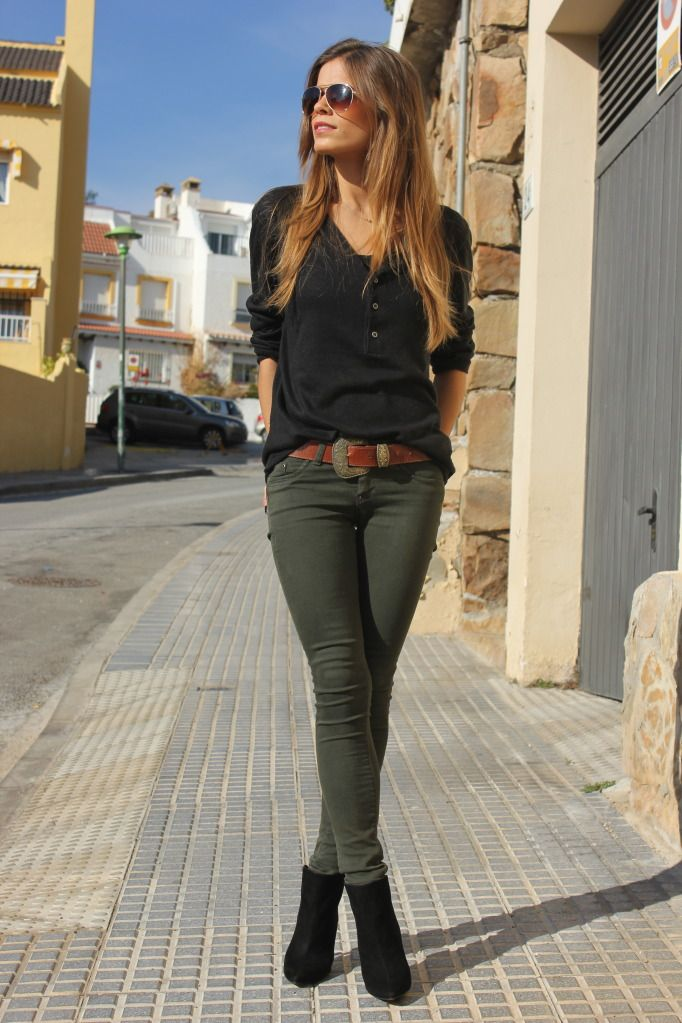 Long sleeve black shirt, a brown leather belt, olive green skinny jeans,  and black booties.