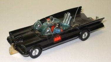 A prized possession: the Batmobile from the 1960s show.  It had a little figure, this buzz saw thingy that popped out in front, and some rocket launchers.  There have been many versions of this before or since, but the image is the one I had as a child.  I can tell because of the oddly painted little Batman in the driver's seat...