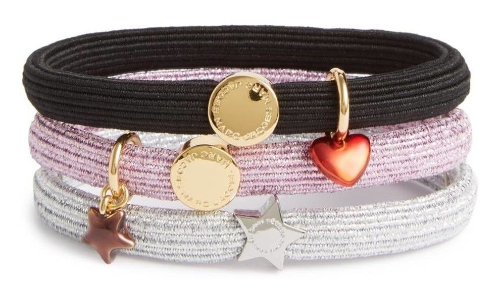 d18adef18c689 A set of three elastic Marc Jacobs hair bands detailed with fun tiny charms.