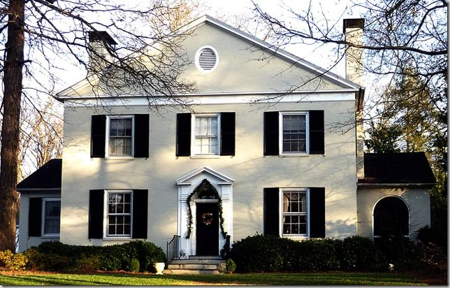 Symmetry - front elevation is symmetrical and balanced (door and windows),  2 smaller