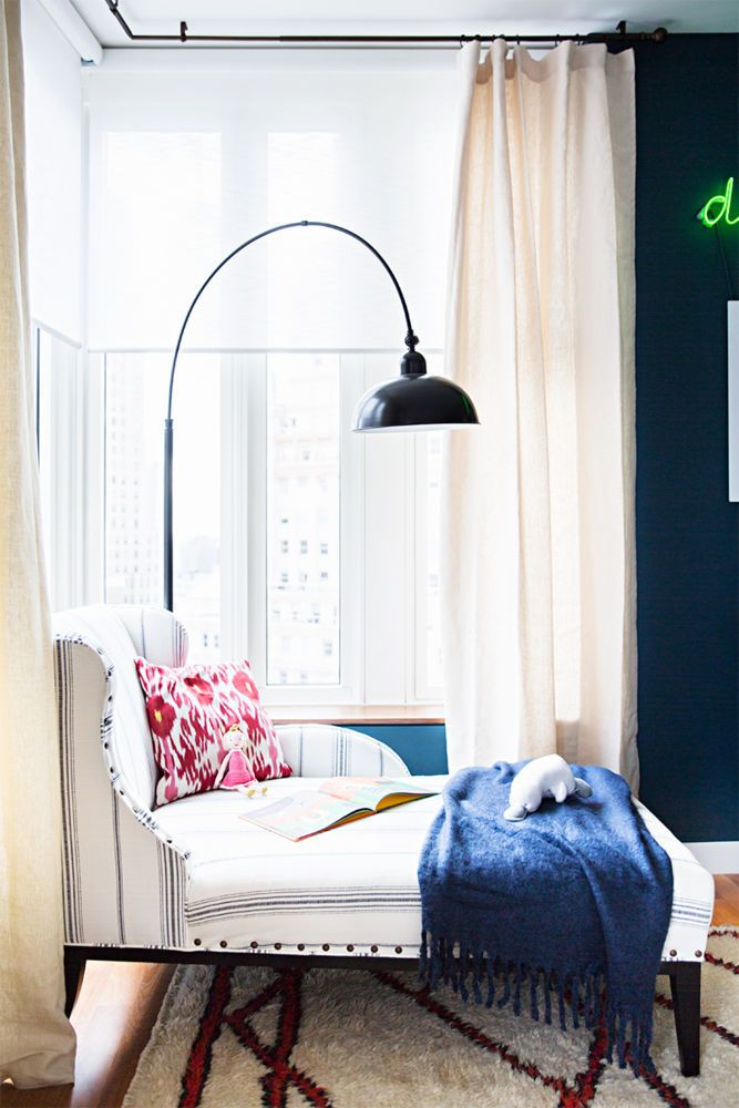 For the domino shophouse dekar design created an inviting vignette in the nursery with a cozy ballard chaise longue and hunter douglas alustra woven