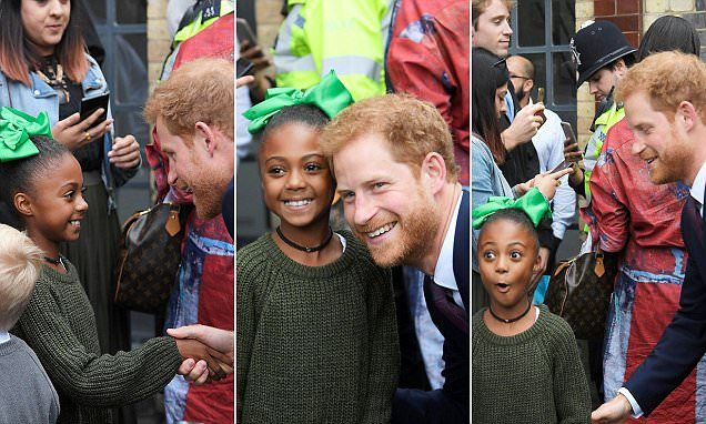 Prince Harry charms child as he visits Grenfell families | Daily Mail Online