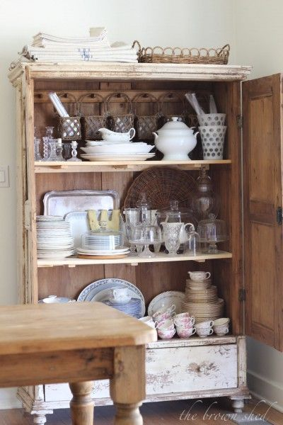 Love those baskets on pegs along the back of this armoire