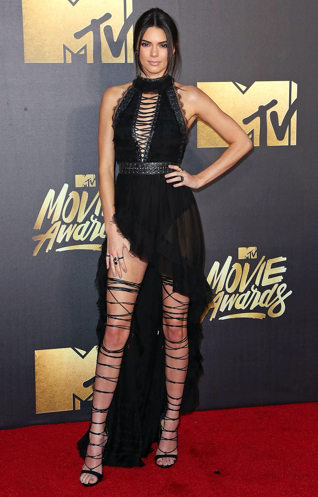 Kendall Jenner in a sheer black DSquared2 dress and lace-up sandals - click  through for more best dressed from the MTV Movie Awards 3ac9b3dd4