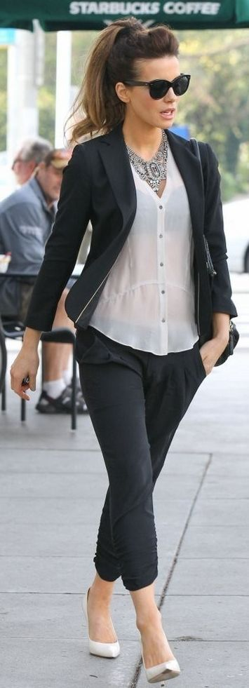 Like the outfit but for me it needs a tank under the blouse rather than just a black bra.