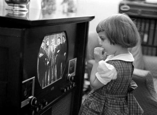 A young fan watches the Beatles on Ed Sullivan.
