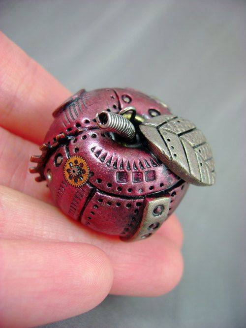 Steampunk Ruby Red Industrial Apple - Steampunk Polymer Clay - Pendant / Necklace. $29.00, via Etsy.