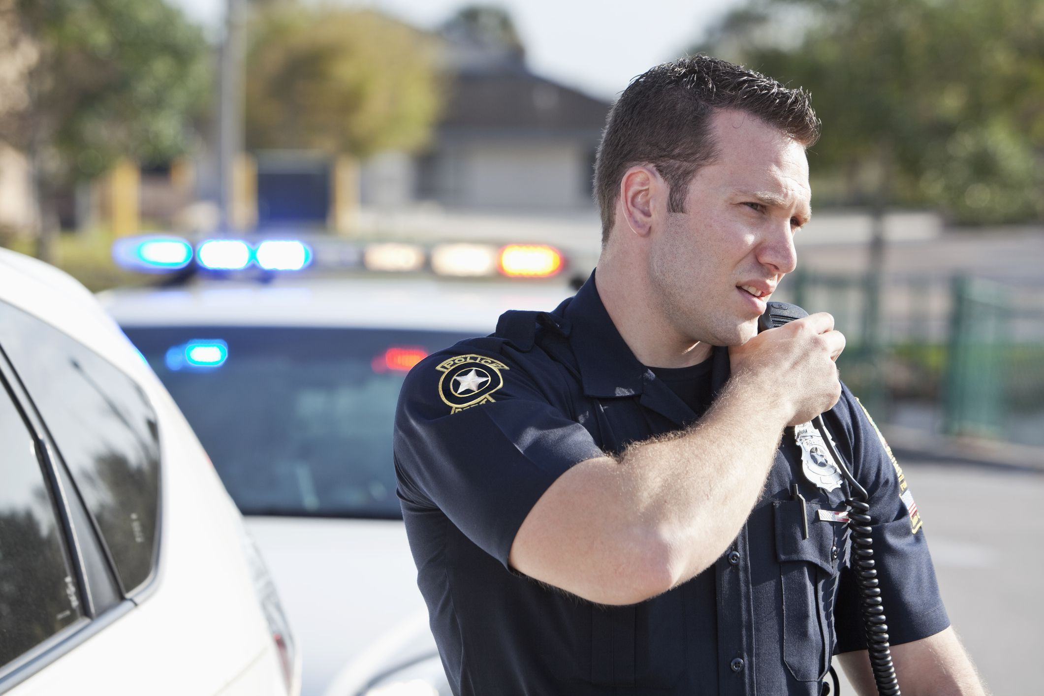 Image result for police speaking into walkie talkie